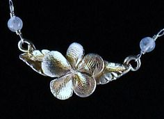 Today I'm very pleased to show you the work of Rain Weingarten, who owns Rain Jewelry. Short but sweet today, I love the way Rain has put the fingerprints into the flower, they are there, but…