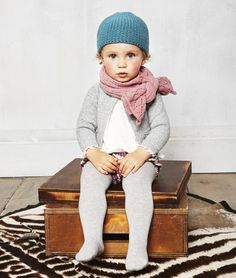 blue hat, pink scarf, and gray sweater for a girl