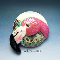 Heather Sellers designed and created this lampwork glass cabochon featuring a flamingo.