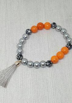 Check out this item in my Etsy shop https://www.etsy.com/ca/listing/511289432/tassel-bracelet-stretchy-bracelet-spring