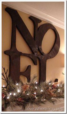 Christmas Mantle Ideas! Noel Christmas Mantel | http://diyready.com/our-20-favorite-mantel-decorating-ideas-christmas-mantel-decor/