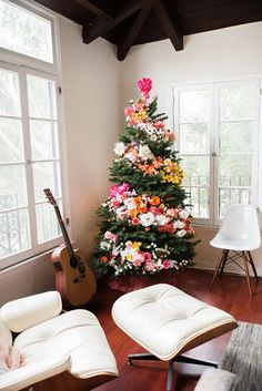 Wow. I'm beyondsmitten with this floral tree thatBri Emeryand her team dreamed up for holidays. It's so flippin' beautiful, I'm this close topurchasing another tree this weekend just so I can make my own. Imagine having this colorful treeup all year round! 365 days of pure joy.Head over