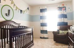 nursery - Google Search; I really like the bunting and the one big stripe on the wall
