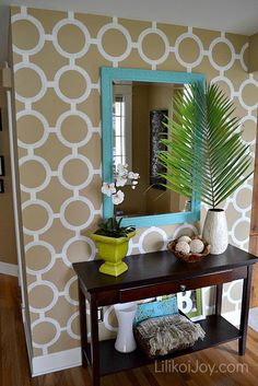 Paint a Patterned Accent Wall. I like the idea of this bright mirror frame, but I'm not sure I'll be able to do a stenciled wall.