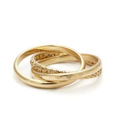 ANNA SHEFFIELD - The InterlockingBands symbolize love eternal with three eternitybands intertwined in perfect harmony. This set combines one gold textureband, one gold smooth half round bandpaired with another gloriously set French pavé diamond band. 0.48ctw champagne diamonds, 2mm  (=)