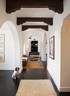 Spanish-revival hallway- love it. These are just like the beams and corbels we had made in Taos for our remodel. Can't wait till it is done.