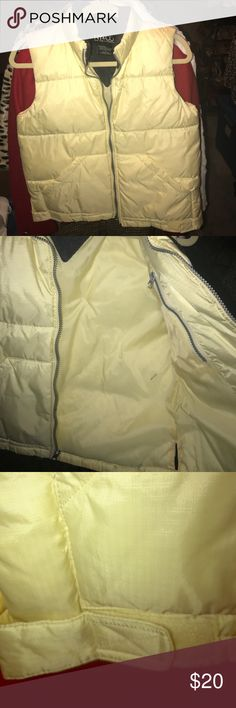 Nylon Down Puffer Vest EUC. Clean. No flaws. Warm Fleece padded collar. Zip front. Front hand pockets. Velcro tans at waist to adjust fit. Hidden interior zipper pocket. Pale yellow with charcoal collar. New York & Company Jackets & Coats Vests