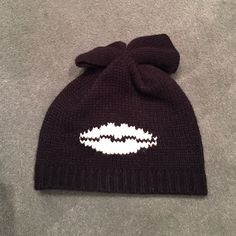Kiss and tell beanie Betsy Johnson kiss and tell beanie with bow on top. Super cute! Betsey Johnson Accessories Hats