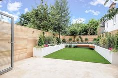 Modern garden design London artificial grass travertine paving render painted raised beds Contact anewgarden for more information Garden Design London, London Garden, Modern Garden Design, Landscape Design, Backyard Patio, Backyard Landscaping, Backyard Layout, Easy Fence, Exterior Makeover