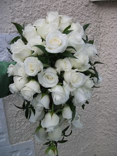 Teardrop bouquet of Akito roses and soft ruscus