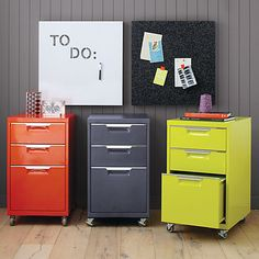 """totally perfect storage. File under """"industrial."""" Mechanic-shop chic powdercoated carbon. Two drawers top a letter/legal file. Stainless steel drawer grips; four casters (front two lock)."""