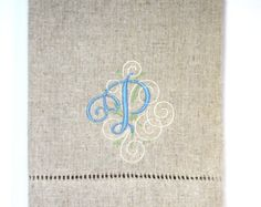 This beautifully simple cross will look amazing in your guest bathroom. This embroidered hand towel can be used for any number of occasions over the years such as at a Baptism or for a First Communion or any Easter season. It is a elegant touch to add to your guest bathroom to celebrate the season. The cross color shown in Mediterranean Blue however we have over 100 color options for embroidering this hand towel. Please contact us directly for customizing this cross to match the decor in…