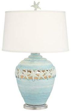 Coastal charm comes home in the Pacific Coast Lighting Starfish Table Lamp . This whimsical table lamp features an organic shaped base with cut-out starfish. Beach Cottage Style, Coastal Cottage, Coastal Homes, Beach House Decor, Coastal Style, Coastal Decor, Coastal Lighting, Lake Decor, Coastal Colors