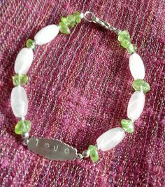 Rose Quartz and Peridot 925 Sterling Silver hand stamped LOVE bracelet Beaded Necklace, Beaded Bracelets, Silver Bars, Love Bracelets, Peridot, Rose Quartz, Hand Stamped, Sterling Silver Jewelry, Etsy Shop