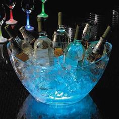 entertaining-party Run to the nearest dollar store and add a glow stick to the bottom of a clear bowl. Pour ice on it and now you have a fun way to chill alcohol…