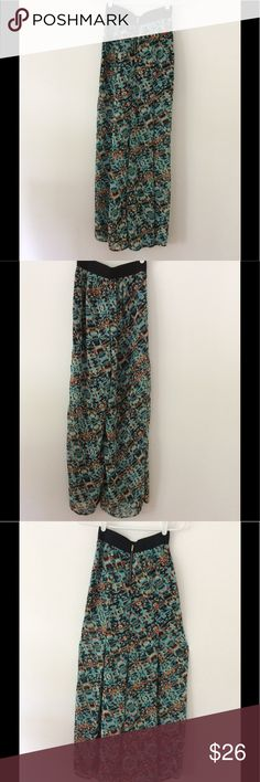 "Carmen Marc Valvo: Palazzo Pants - Size XS Turn heads with these Palazzo's! Muted colors of teal,orange,brown & yellow. Sheer...lined 12"" down from below waistband, pleats (pic 3) Shell:100% Polyester Lining:96% Polyester 4% Spandex Length 41 1/2"" Waist 24"" Smoke Free/Dog Friendly Home🌸 Carmen Marc Valvo Pants Wide Leg"