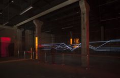 """Created by St. Petersburg artist collective VOLNA, Powerline is an audio reactive installation comprised of 220 meters of electroluminescent wire driven by 15 meter """"voltaic arc"""" filling the space with electric buzz and sparks."""