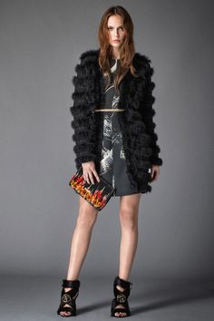 Reach for a black fur coat and a black and white graphic shift dress to steal the show. A pair of black fur heeled sandals will seamlessly integrate within a variety of outfits.   Shop this look on Lookastic: https://lookastic.com/women/looks/fur-coat-shift-dress-heeled-sandals/22976   — Black and White Print Shift Dress  — Gold Waist Belt  — Black Fur Coat  — Black Print Leather Clutch  — Black Fur Heeled Sandals