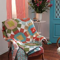 Choose a set of 18 coordinated prints and a cream background fabric, then have some fun. This quilt pattern by Leanne Harvey uses the traditional Rolling Stone block in an extravaganza of non-traditional colours to create a quilt with lots of pizzazz.
