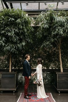 This couple had an intimate elopement in their home city of Brooklyn that included a greenhouse ceremony, a picnic for two, and 1920s inspired bridal style.