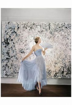 Model wearing a pale blue ball gown, ph Cecil Beaton. Backdrop art work: Jackson Pollock's Abstractions NYC 1951