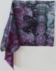 Nui Shibori snow dyed cotton -  a lightweight cotton that was light olive in colour before it was dyed. The Nui shibori designs were made by stitching circles and diamonds.