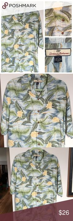 Men's Tommy Bahama Silk Hawaiian Shirt Men's Tommy Bahama Silk Hawaiian Camp Shirt. Features: soft 100% silk, beautiful Island print featuring palm trees, ocean, tropical flowers and other foliage. Also features: coconut buttons, camp style collar, and Tommy Bahamas quality and style. Condition: very good!!! Tommy Bahama Shirts Casual Button Down Shirts