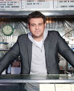 Adam Richman... yeah, it doesn't make any sense.  He is the host of Man V. Food.  Which is a vulgar display of over indulgence and excess... but, he is adorable and funny.  Don't judge me!