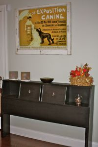 Repurposed bookcase headboard into console table!  I sort of love this!