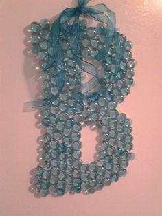 DIY - custom monogram letter art in blue glass, all letters available. $24.99, via Etsy.