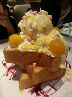 Honey toast tower topped with mango ice cream