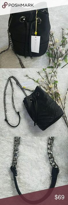 BCBG Dance First Think Later Bucket Bag Chic bucket bag, versatile to dress up or down with any outfit. Features adjustable drawstring, magnet clip closure and a dark silver chain  strap and dark silver accents. Brand New with Tags!  REASONABLE OFFERS WELCOME. BCBGeneration Bags