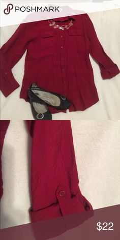 Gorgeous burgundy blouse Burgundy/crimson long sleeved blouse. Very light weight. 80 rayon 20 nylon.  Color is rich & can be dressed up or down.  Long sleeved, but does have the cuff strap so it can be versatile to your needs. Excellent condition. No flaws. Van Heusen Tops