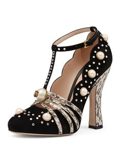 "Gucci suede and snakeskin pump with glass pearls and crystal studs. Center glass pearl stud with gold tone feline head. 4"" curved snakeskin heel. Pointed toe. Strappy T strap vamp. Scalloped collar. A"