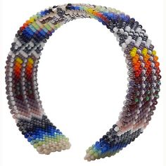 $110.00 Beaded Beautiful rows of colorful beadwork radiate in all directions on this gorgeous bracelet by local Lakota Sioux beadwork artist Michael Running Shield. The pattern is Michael's signature style of feathers and lodges.