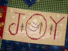 Joy Snowman Christmas Cross Stitch pattern on Craftsy.com