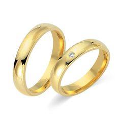 Elegant klassische Trauringe aus 585er Gelbgold mit einem Diamant www.thejewellershop.com #eheringe #hochzeit #trauringe #gelbgold #thejeweller #ringe #partnerringe