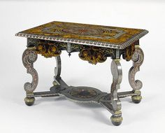 A table (1680-1685) gilded bronze mount and Oak veneered with beautiful  marquetry inlaid with tortoiseshell, pewter, brass, ebony, horn, ivory, and various natural and stained woods