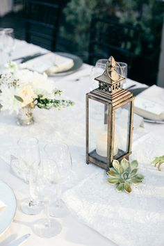 simple succulent and lantern centerpiece idea // Photo by onelove Photography