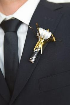 Noisemaker boutonniere - If you must go formal, why wear something ordinary?! <3