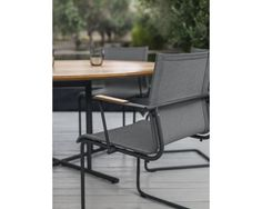 Sway Stacking Chair with Arms designed by HENRIK PEDERSEN for Gloster .