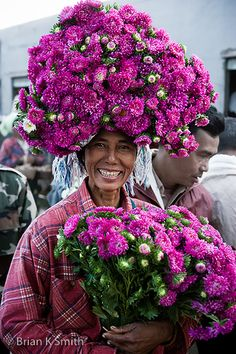 In the mountain village of Myin Daik, the local flower lady sells her colourful bouquets to passagers at the train station . Myanmar