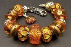 Rays of Sunshine. A beautiful bracelet with an Amber bead as the focal bead from a member on Trollbeads Gallery Forum! Join us!