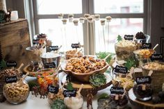 Check out this trail mix bar at a woodland boho baby shower party! See more party planning ideas at CatchMyParty.com!