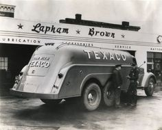 Two men stand beside an International truck owned by Texaco. The truck is parked outside Lapham Brown Texaco service station. Old Gas Pumps, Vintage Gas Pumps, Vintage Trucks, Old Trucks, Pin Up Girls, Fuel Truck, Pompe A Essence, Retro, Biker