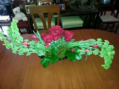 Red roses, red tulips, bells of Ireland Grafe Studio Floral Artist Faith Pressley Chattanooga Tennessee