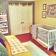 Gray and yellow nursery featuring yellow accent wall