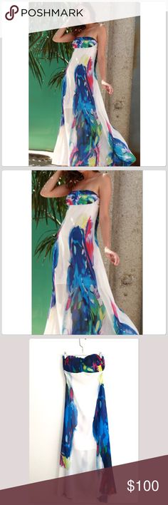 NWT Mesmerizing Blue/White Strapless Maxi Dress This is such a beautiful colorful maxi dress! The colors are amazing! It is lined with a slip dress underneath it! It has a nice back zipper and is so comfortable on! It has a pleated top which enhances the chest! It is an A line shaped dress! This is perfect for any special occasion! It would also make a gorgeous prom dress! Bust 16 Length 48 Boutique Dresses Prom