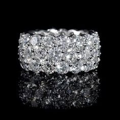 This fabulous 18k white gold three row eternity wedding band ring, features 51 round brilliant cut white diamonds, of F color, VS2 clarity and excellent cut and brilliance, weighing 11.91 carats total.