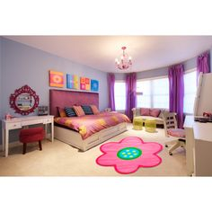 Enjoy the splash of color this novelty rug will bring into your child's room. This bright rug is a lovely addition to any space in needs of some extra cheerfulness.